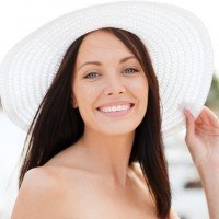 photodune-5506934-girl-in-hat-standing-on-the-beach-xs-200x200